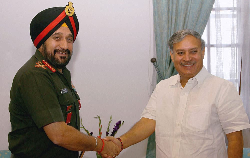 Minister of State for Defence Inderjit Singh Rao at a meeting with Army Chief Gen Bikram Singh at South Block in New Delhi.