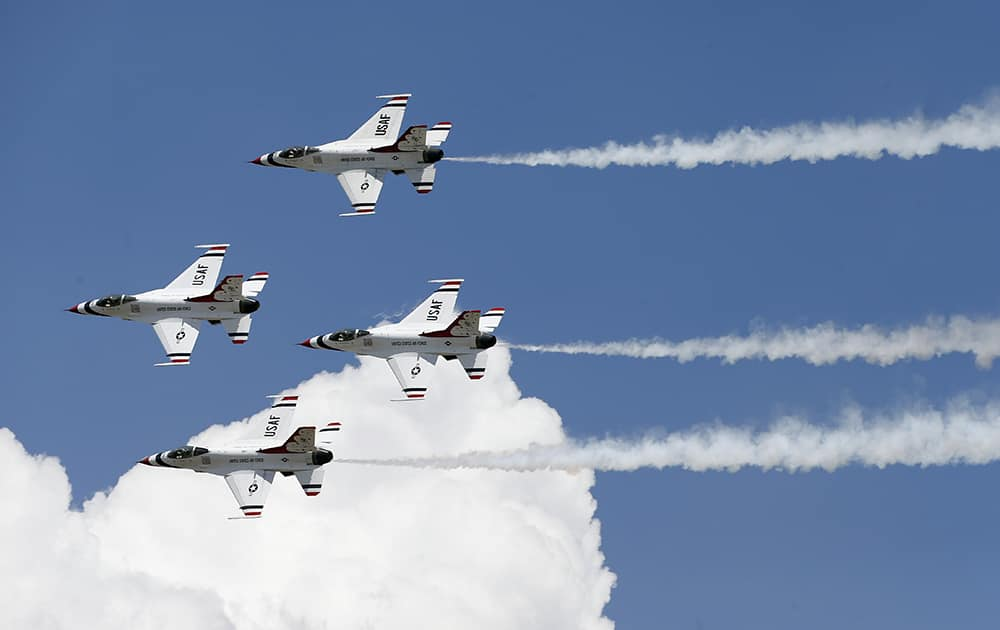 F-16 jets from the Thunderbirds perform after the completion of the graduation ceremony for the Air Force class of 2014, at the U.S. Air Force Academy, Colo.