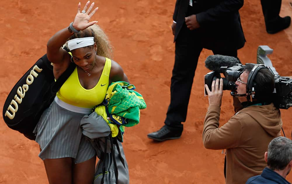 Serena Williams of the US leaves after losing her second round match of the French Open tennis tournament in two sets 2-6, 2-6, against Spain`s Garbine Muguruza at the Roland Garros stadium, in Paris, France.