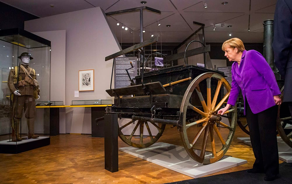 German Chancellor Angela Merkel, looks at a horse drawn field kitchen in a World War I exhibition at the Historical Museum in Berlin.