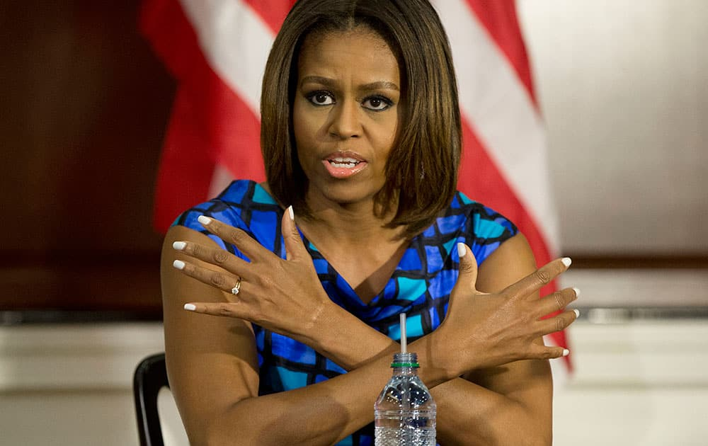First lady Michelle Obama joins a discussion with school leaders and experts surrounding school nutrition in an event in the Eisenhower Executive Office Building on the White House complex in Washington.