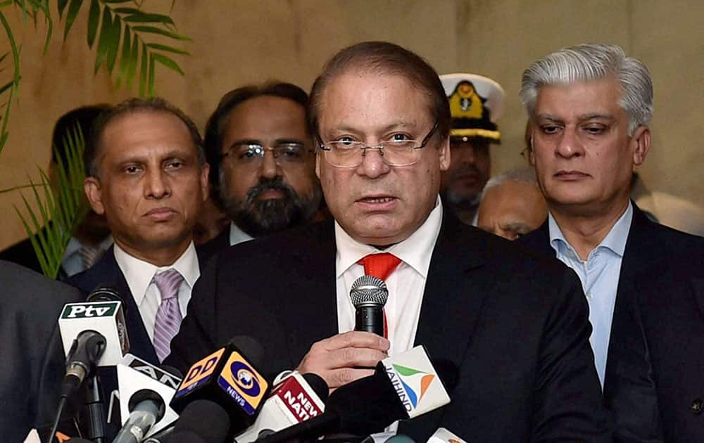 Pakistani Prime Minister Nawaz Sharif , center, talks to the media after meeting India`s new prime minister Narendra Modi and before leaving from New Delhi.
