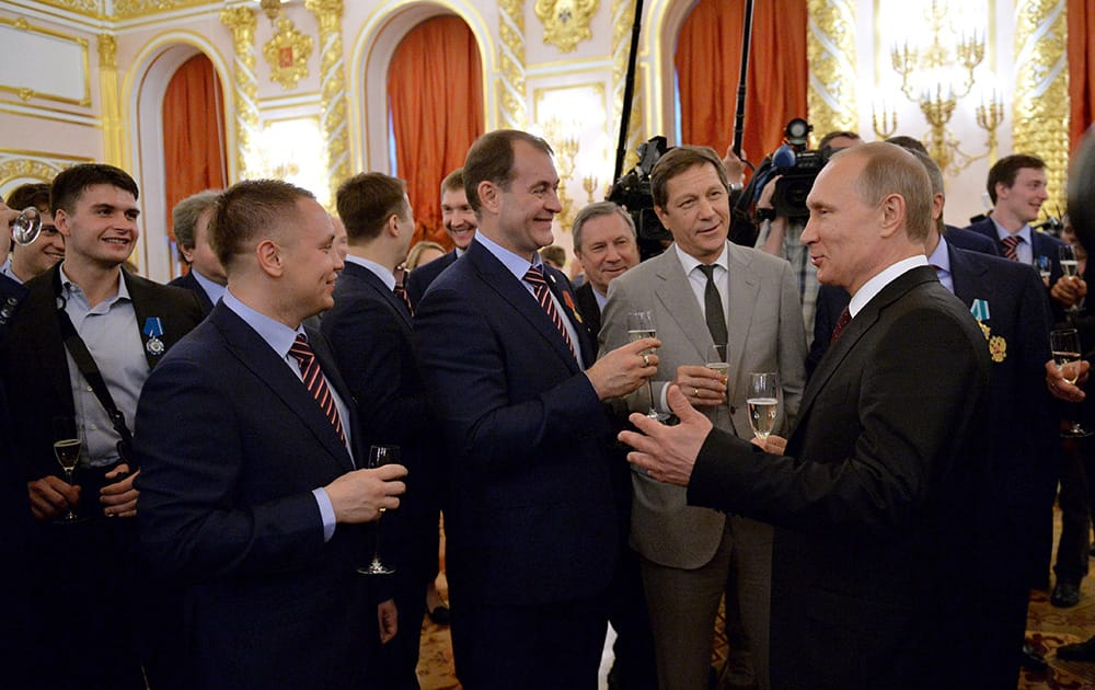 Russian President Vladimir Putin speaks with ice hockey national team players and officials at a ceremony honoring the victory at the Ice Hockey World Championship, in the Kremlin in Moscow.