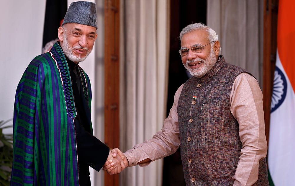 Prime Minister Narendra Modi shakes hand with Afghan President Hamid Karzai before the start of their meeting in New Delhi.