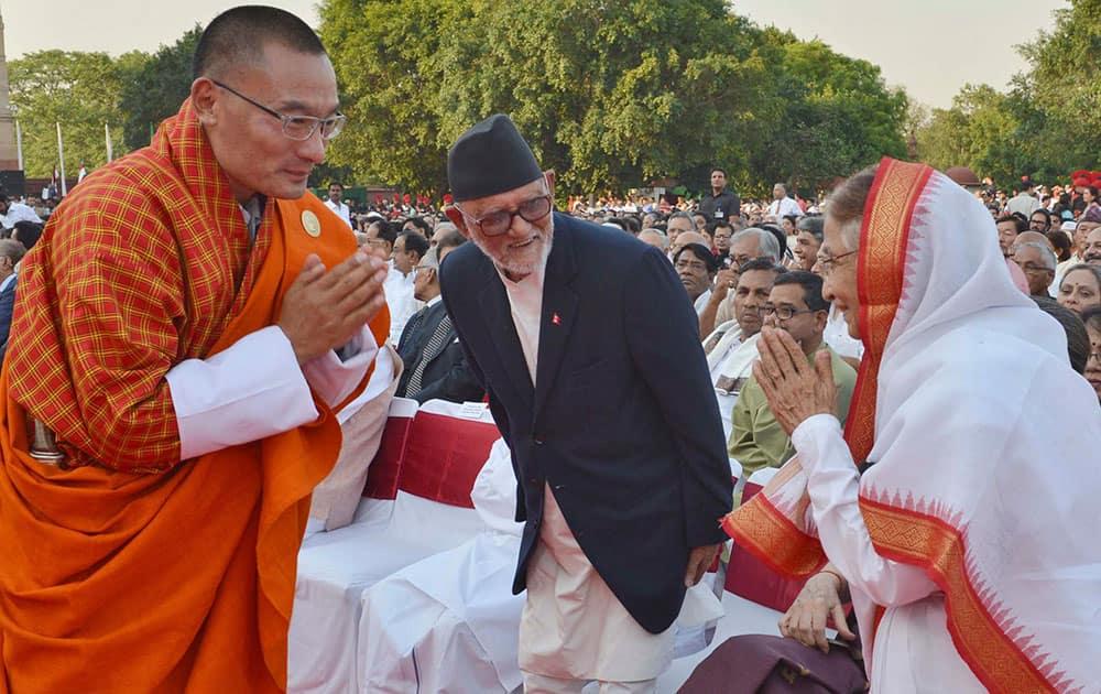 Bhutanese Prime Minister Tshering Tobgay, left, greets former Indian president Pratibha Patil, right, as Nepalese Prime Minister Sushil Koirala, center, watches during the inauguration of India`s new prime minister Narendra Modi in New Delhi.