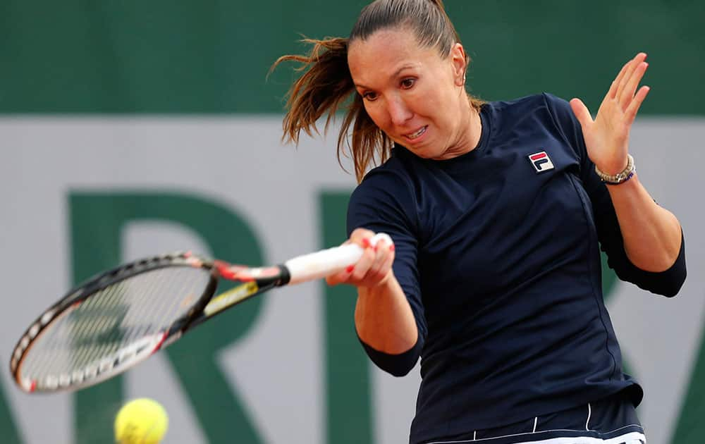 Serbia`s Jelena Jankovic returns the ball to Canada`s Sharon Fichman during the first round match of the French Open tennis tournament at the Roland Garros stadium, in Paris.