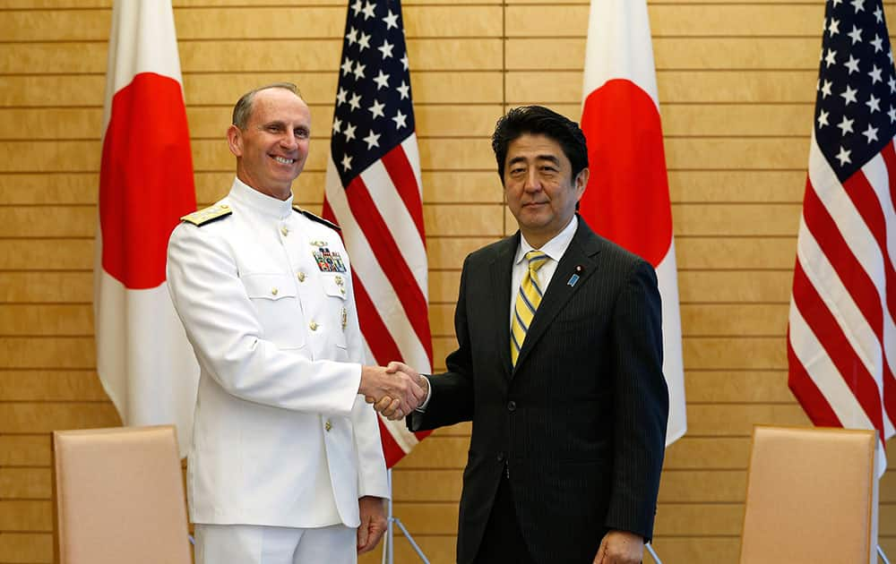 U.S. Chief of Naval Operations Adm. Jonathan Greenert, left, poses with Japanese Prime Minister Shinzo Abe for photographers before the start of their meeting at Abe`s official residence in Tokyo.