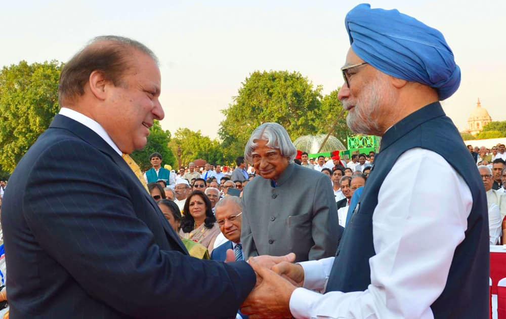 In this photo released by the Indian President`s office, India`s outgoing Prime Minister Manmohan Singh, right, greets Pakistani Prime Minister Nawaz Sharif, left, as former Indian president A P J Abdul Kalam, center, watches during the inauguration of new prime minister Narendra Modi in New Delhi, India.