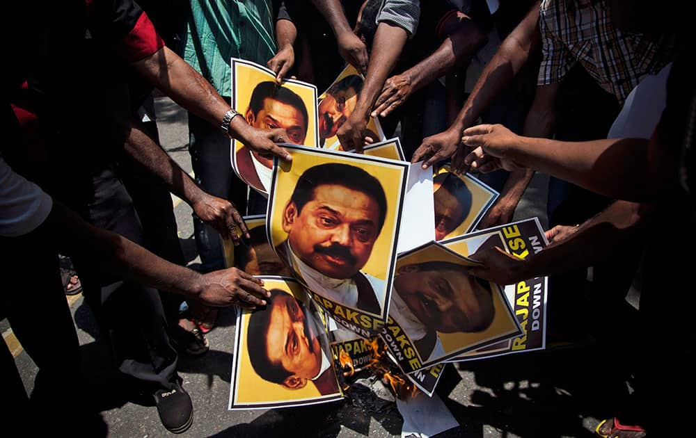 Supporters of Marumalarchi Dravida Munnetra Kazhagam (MDMK) burn portraits of Sri Lankan President Mahinda Rajapaksa during a protest in New Delhi.