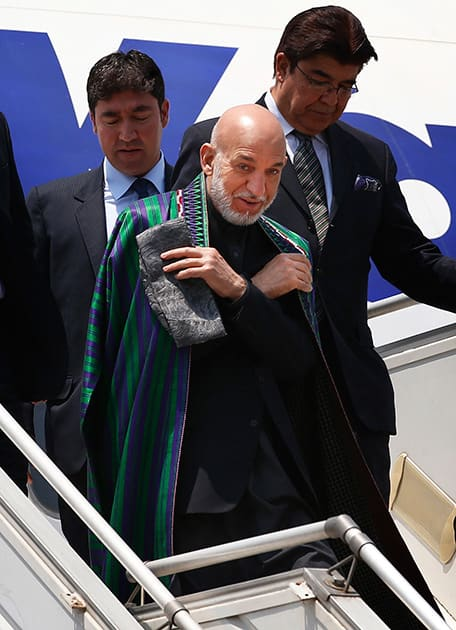 Afghan President Hamid Karzai arrives in India to attend the swearing in ceremony of prime minister elect Narendra Modi in New Delhi.
