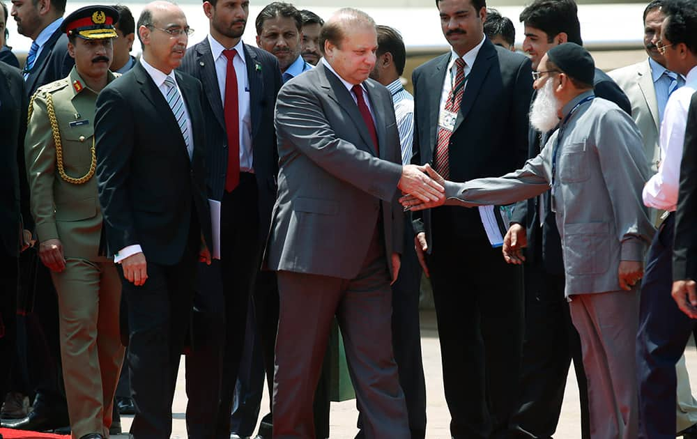 Pakistani Prime Minister Nawaz Sharif greets people as he arrives to attend the swearing in ceremony of Indiaâ??s prime minister elect Narendra Modi in New Delhi.