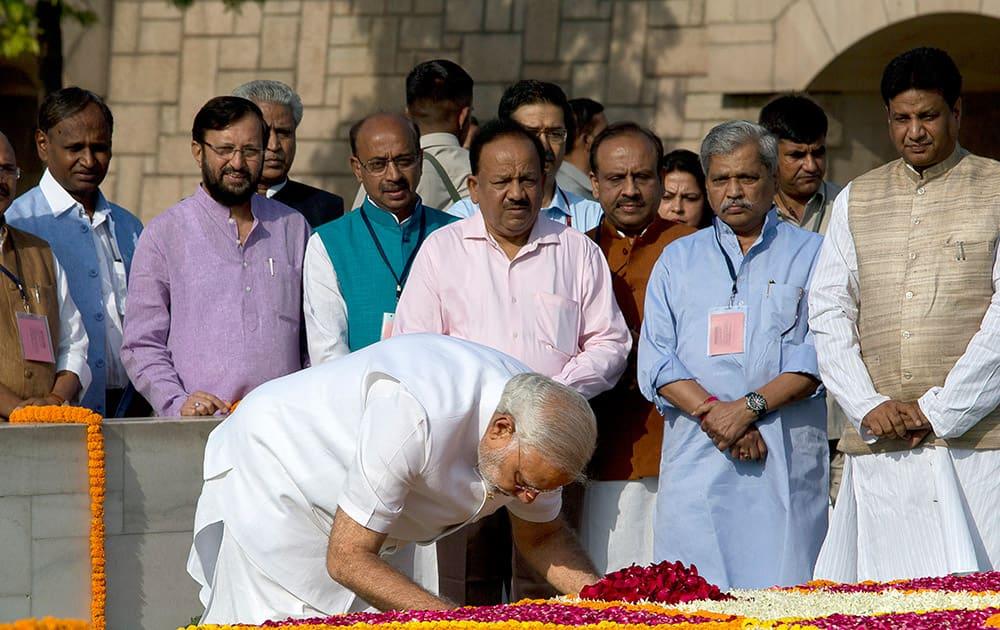 Narendra Modi pays his respects at Rajghat, the memorial of Mahatma Gandhi, in New Delhi.