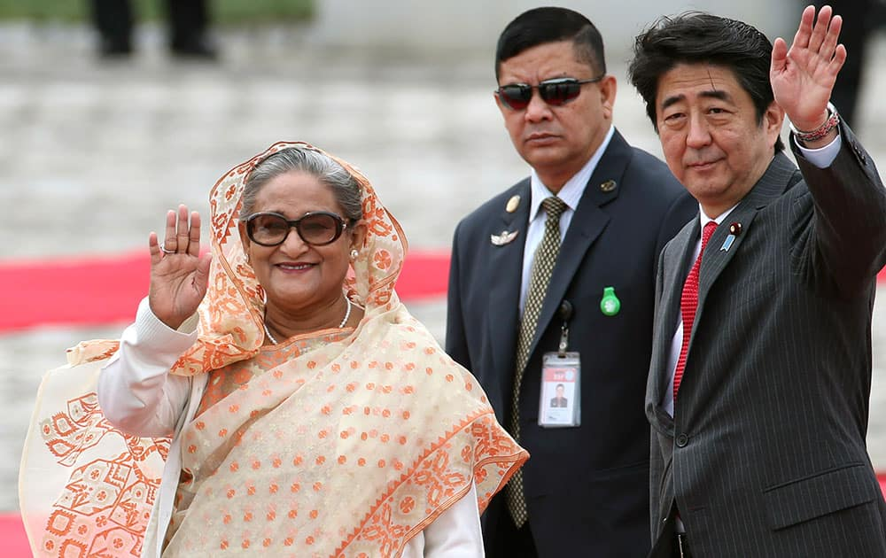 Bangladesh`s Prime Minister Sheikh Hasina waves during a welcome ceremony with Japanese Prime Minister Shinzo Abe, right , at Akasaka State Guest House in Tokyo.