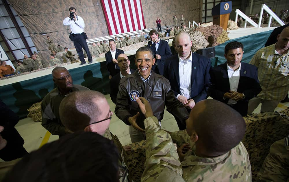 President Barack Obama shakes hands at a troop rally at Bagram Air Field, north of Kabul, Afghanistan, during an unannounced visit.