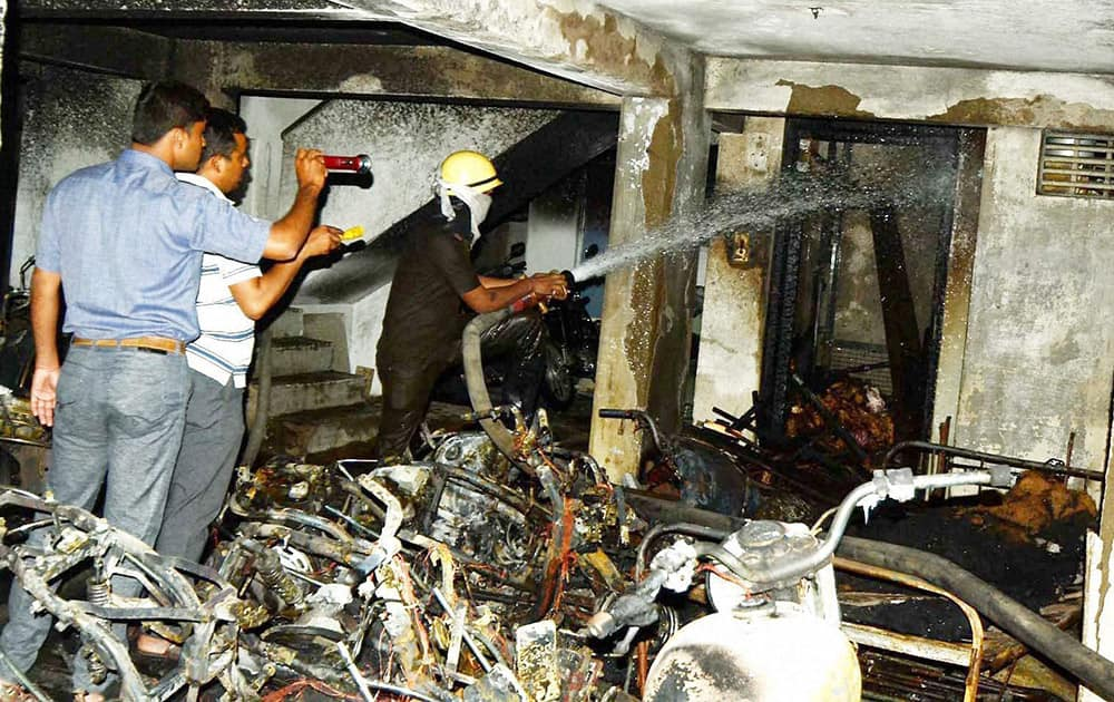 Fire fighters douse a fire that broke out in a lift in Nagpur.