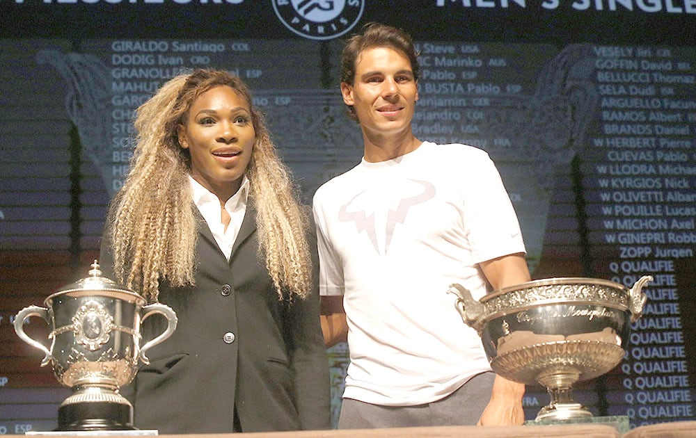 Defending champions Serena Williams, of the U.S, left, and Spain`s Rafael Nadal pose during the draw for the French Open Tennis tournament, at the Roland Garros stadium in Paris.