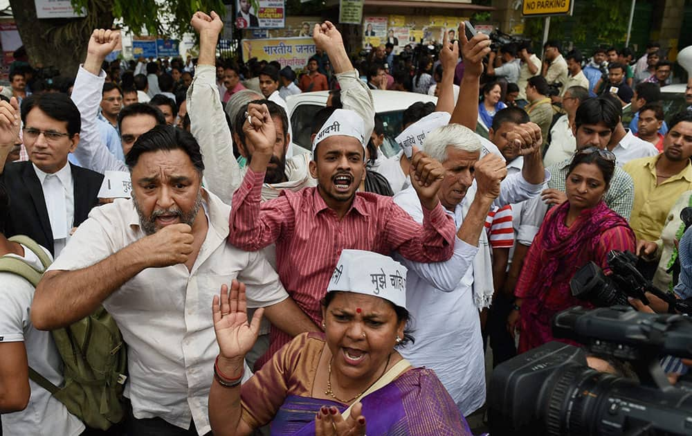 AAP activists protest in support of party chief Arvind Kejriwal outside the Patiala House court in New Delhi.