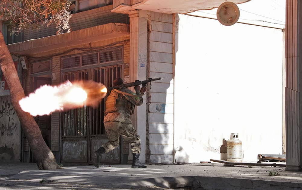 An Afghanistan`s National Army (ANA) soldier fires his weapon at the site of a clash between insurgents and security forces over Indian Consulate in Herat, Afghanistan.