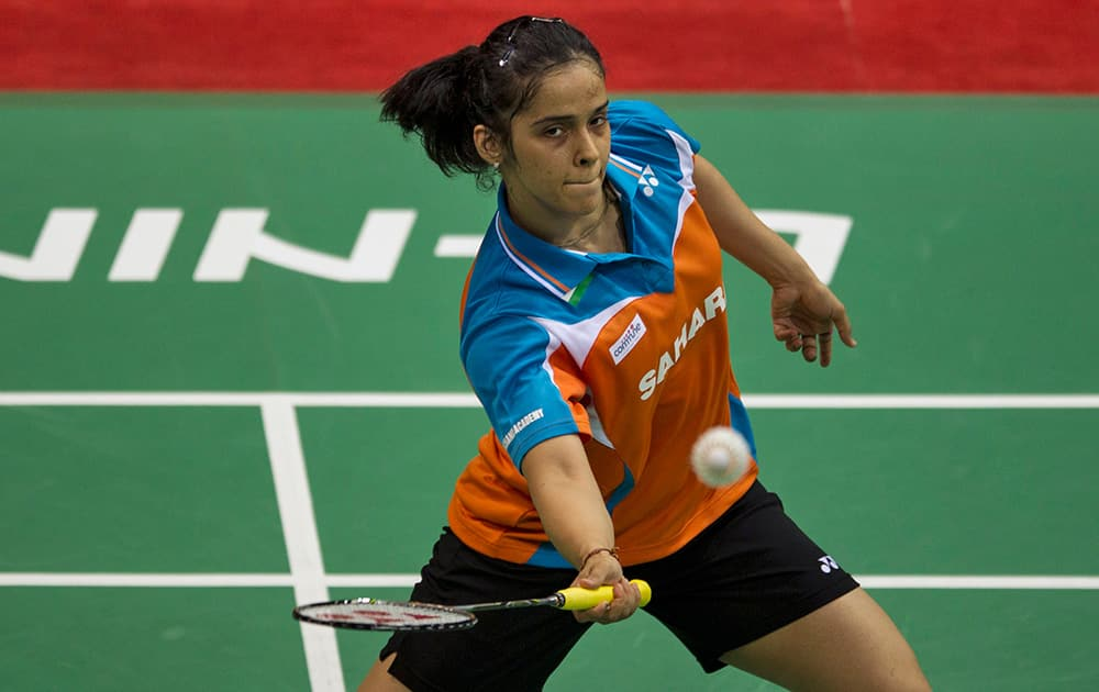 Saina Nehwal returns a shot to Indonesia's Lindaweni Fanetri during their quarter final match of women`s singles event at the Uber Cup Badminton in New Delhi.