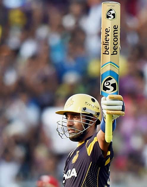 KKR batsman Robin Uthappa celebrates his fifty runs during their IPL match against RCB at Eden Garden in Kolkata.