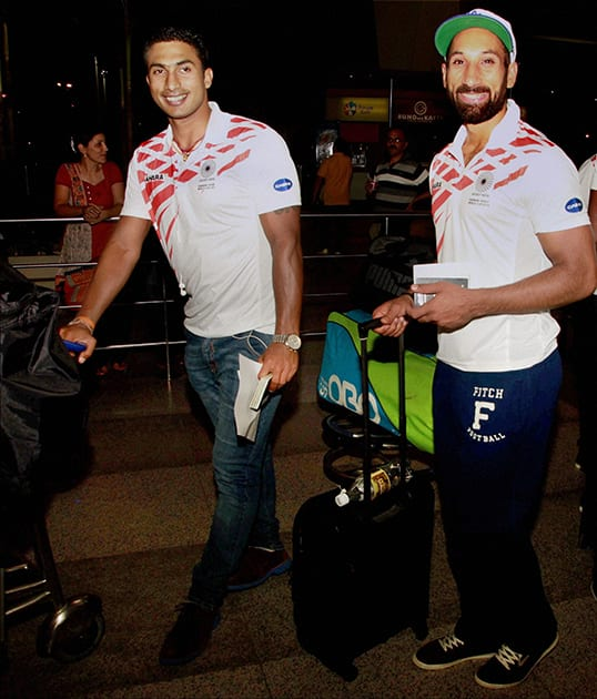 Indian hockey team skipper Sardar Singh with a team mate at the IGI airport in New Delhi on Wednesday night before their departute for the World Cup to be held at The Hague, Netherlands from May 31 to June 15.