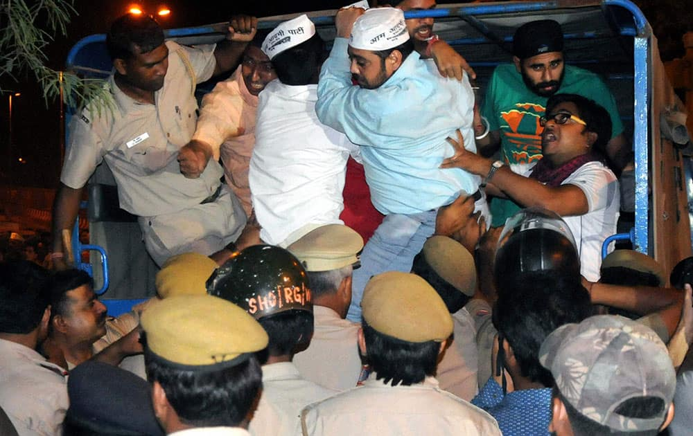 Police in action against AAP supporters who were protesting outside Tihar Prisons over the arrest of party chief Arvind Kejriwal in New Delhi.