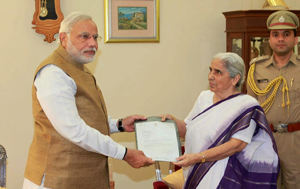 Prime Minister-elect and outgoing Chief Minister Narendra Modi submits his resignation letter to Gujarat Governor Kamla Beniwal in Gandhinagar.