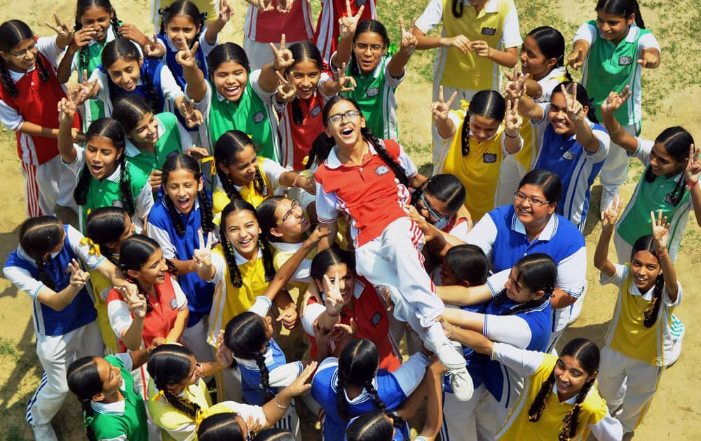 Students of a school in a jubilant mood after the declaration of CBSE class X results in Patiala.