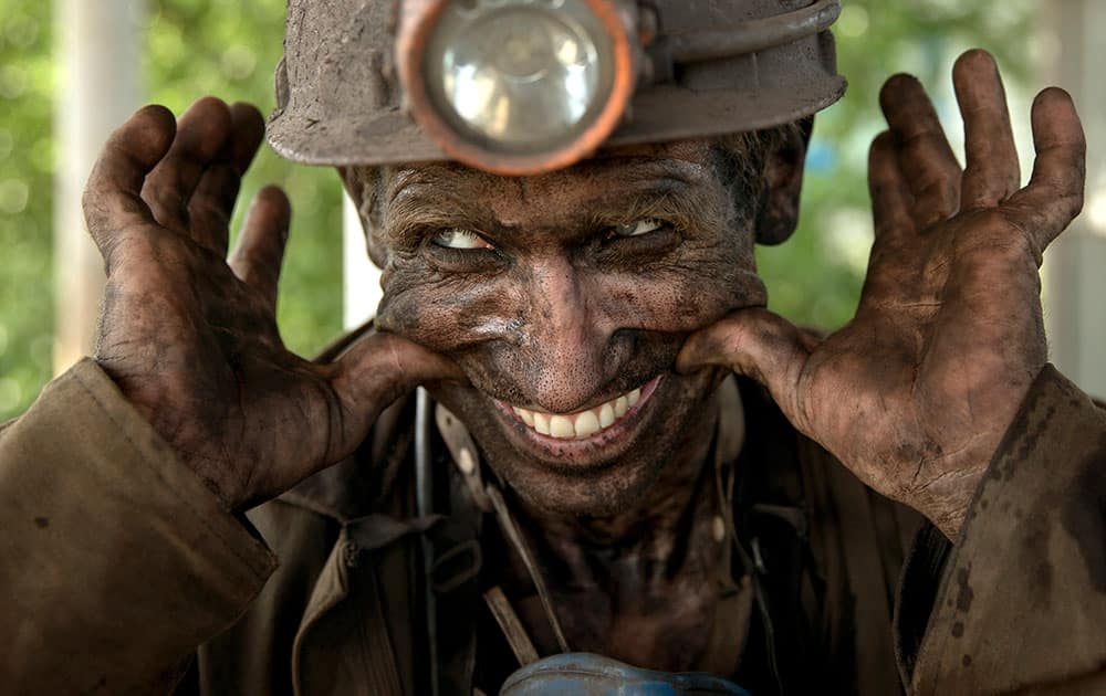A Ukrainian coal miner smiles, after finishing his shift at a coal mine outside Donetsk, Ukraine.