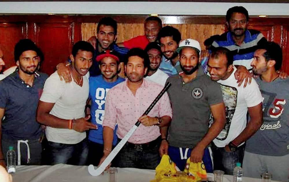 Cricket legend Sachin Tendulkar visiting the World Cup-bound Indian hockey team in New Delhi on Tuesday ahead of the side`s departure for the quadrennial event to be held at The Hague, Netherlands from May 31 to June 15.