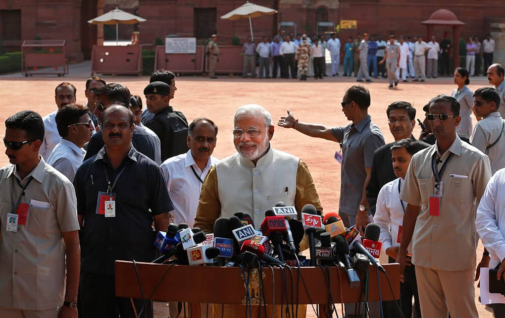 Narendra Modi addresses the media after meeting the Indian President, outside the Presidential Palace in New Delhi.