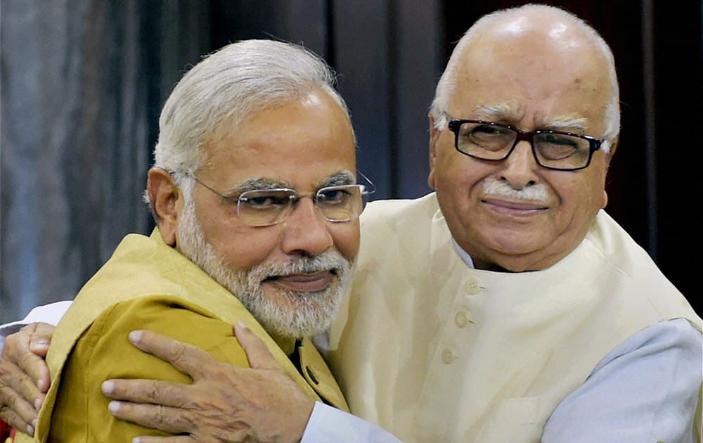 Narendra Modi hugs party leader Lal Krishna Advani during the BJP parliamentary party meeting in New Delhi.
