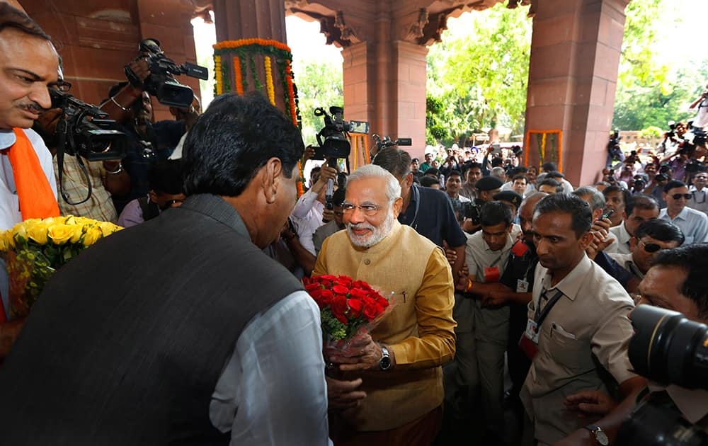 Narendra Modi is received with flowers as he arrives for the BJP parliamentary party meeting in New Delhi.