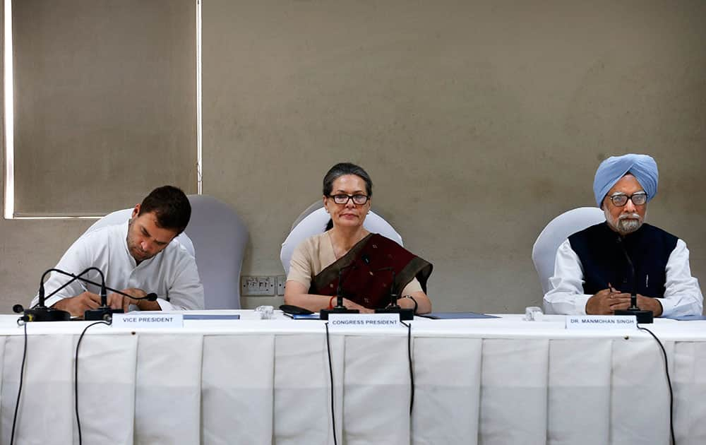 India's outgoing prime minister Manmohan Singh, right, Congress party president Sonia Gandhi, center, and party vice president Rahul Gandhi, attend a meeting of the Congress Working Committee to review the party's defeat in the general elections in New Delhi.