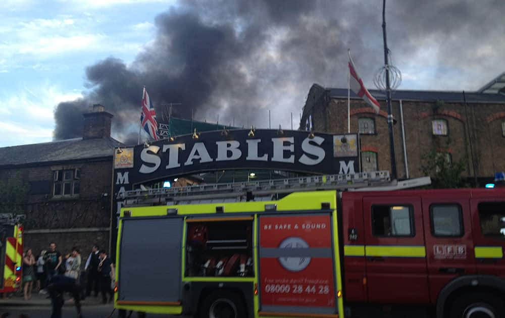Smoke rises from the Stables Market area of Camden Town, central London. The area was evacuated by the fire services.