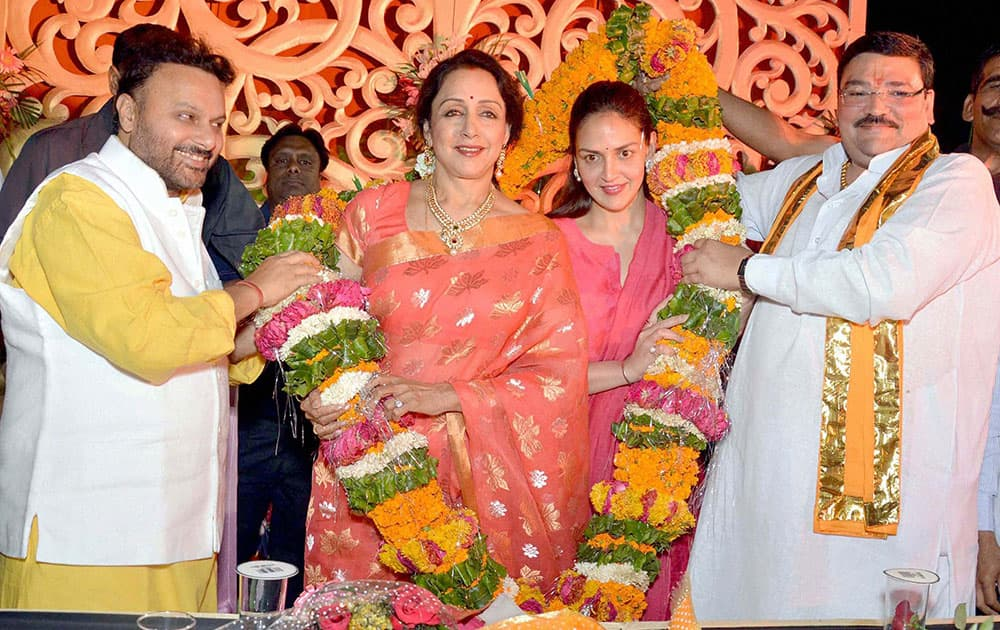 Mathura: BJP`s winning candidate Hemamalini is garlanded along with her daughter Esha Deol at a felicitation function in Mathura.