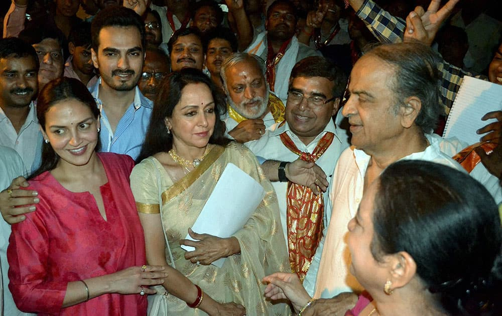Bollywood actress and BJP candidate Hemamalini along with her daughter Esha Deol and son-in-law Bharat leaving from the counting station after getting certificate of win in Lok Sabha elections in Mathura.