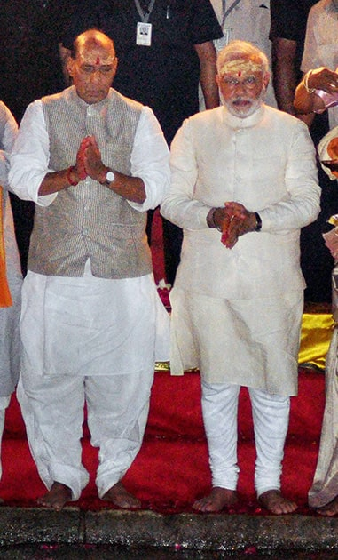 BJP leader and the next Prime Minister Narendra Modi with party President Rajnath Singh performing Ganga Aarti in Varanasi.