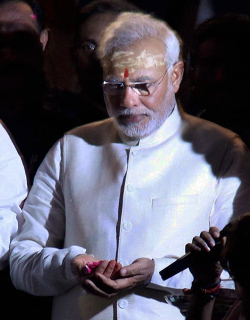 BJP leader and the next Prime Minister Narendra Modi prays to Ganga during the Aarti in Varanasi.