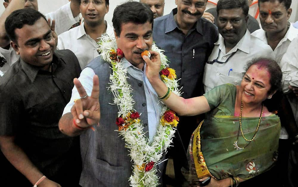 BJP candidate Nitin Gadkari being offered sweets by his wife Kanchan after his win in Lok Sabha elections in Nagpur.