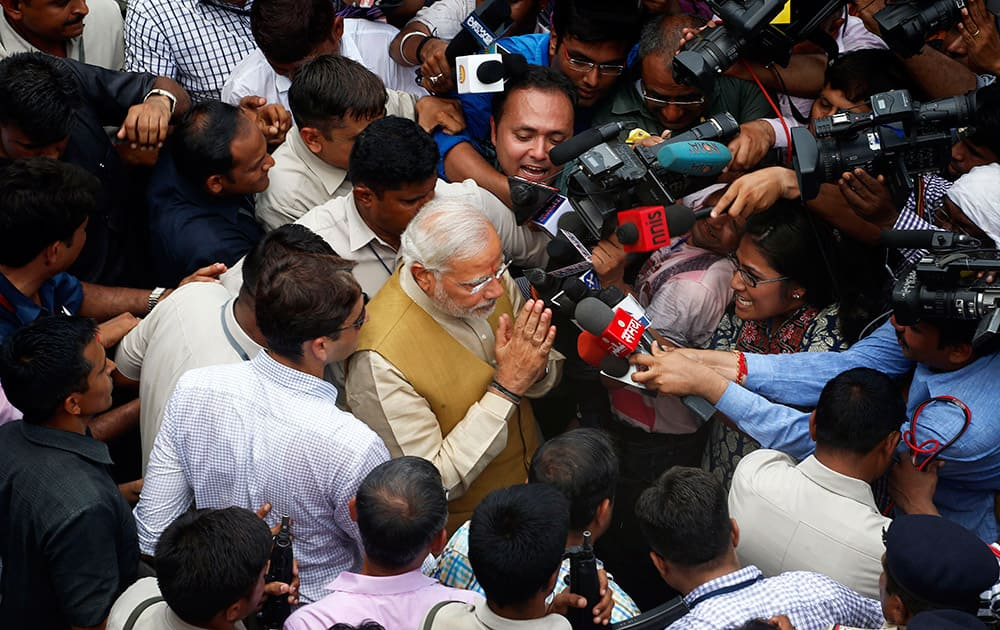 12:35 P.M.- Bharatiya Janata Party (BJP) leader and India`s next prime minister Narendra Modi greets the media as he leaves the residence of his 90-year-old mother in Gandhinagar, in the western Indian state of Gujarat.