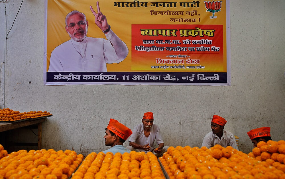 Workers prepare sweets anticipating election victory for the Bharatiya Janata Party (BJP) at the party's headquarters, in New Delhi.
