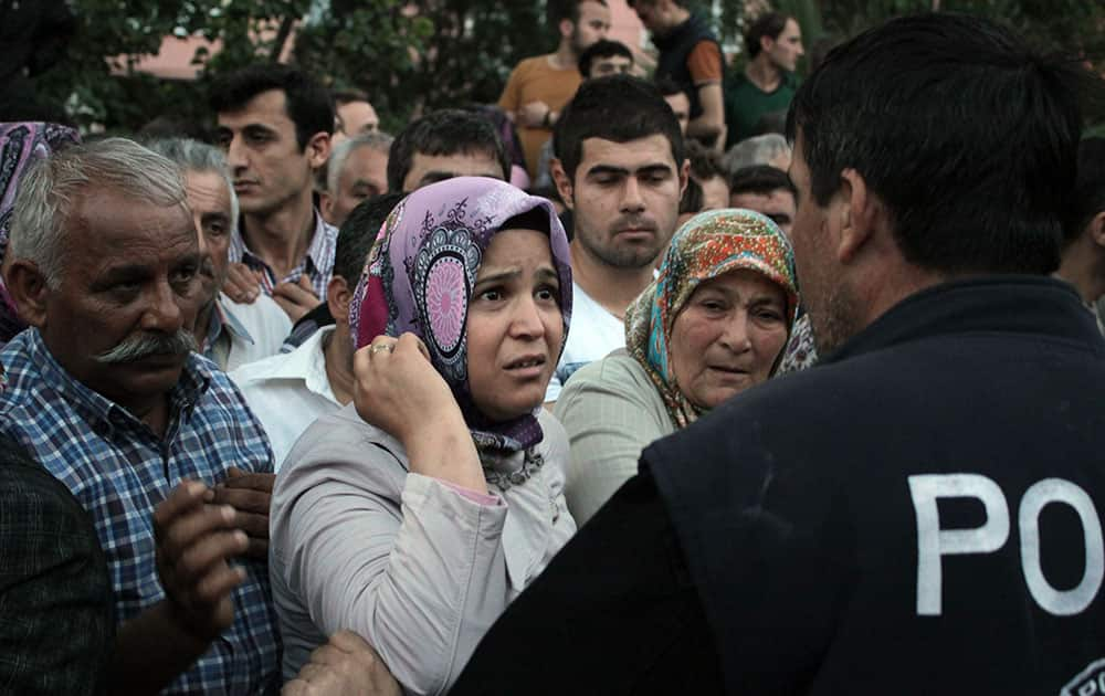 Relatives try to get information outside a local hospital after an explosion and fire at a coal mine in Soma, in western Turkey.