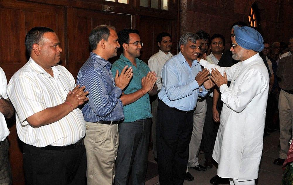 Prime Minister Manmohan Singh bidding farewell to the staff at the PMO in New Delhi.