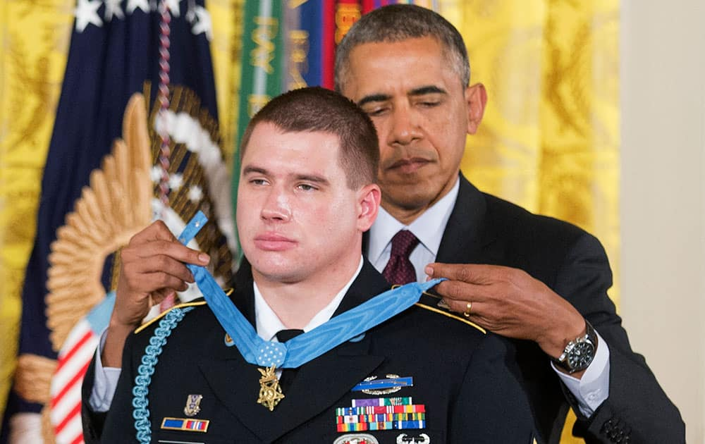 President Barack Obama awards the Medal of Honor to former Army Sgt. Kyle J. White during a ceremony in the East Room of the White House in Washington.