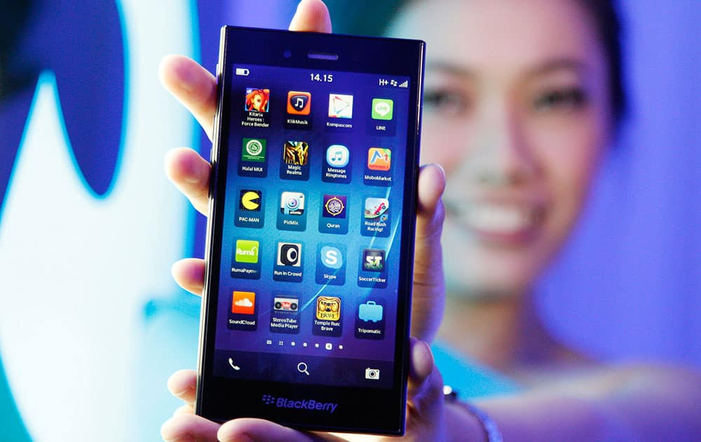 A Blackberry Z3 smartphone is shown by a model during its launch in Jakarta, Indonesia. The Z3 is priced at (US$200) in the country.
