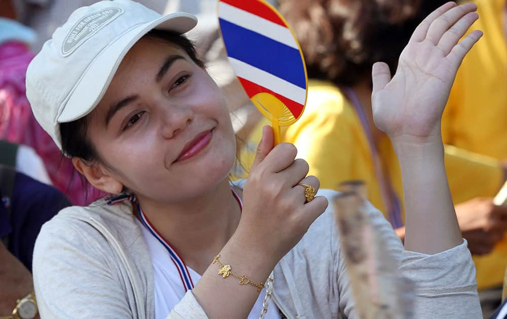 An anti-government protester cheers to a speech during a rally outside the Parliament in Bangkok, Thailand.
