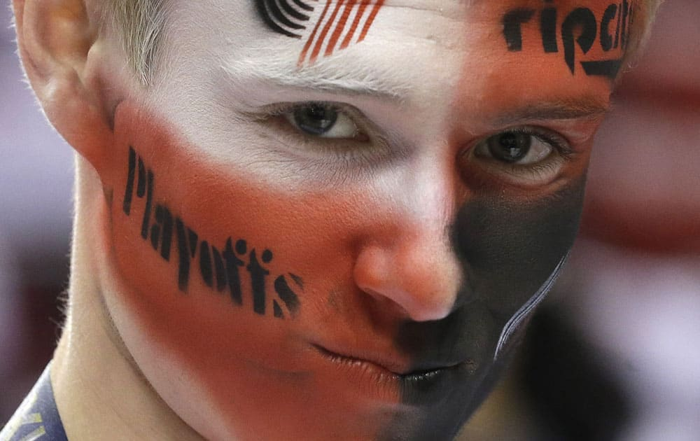 Portland Trail Blazers fan Jacob Weis watches practice before Game 4 of a Western Conference semifinal NBA basketball playoff series against the San Antonio Spurs in Portland, Ore.