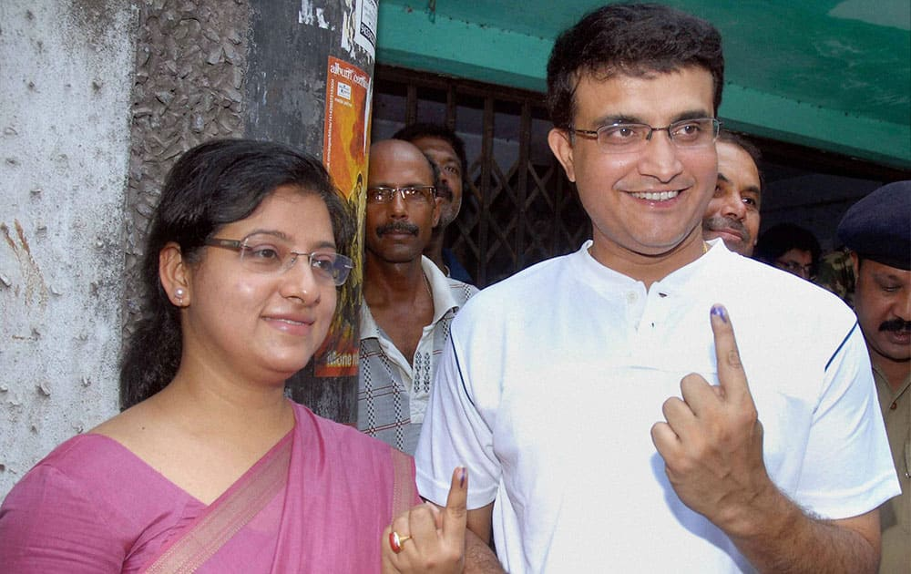 Sourav Ganguly and his wife Dona Ganguly show their marked fingers after casting their votes for the last phase of Lok Sabha elections in Kolkata.