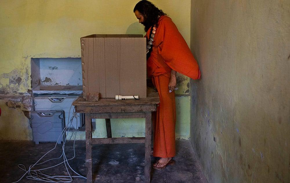 A Sadhu casts his vote at a polling station in Varanasi, Uttar Pradesh.